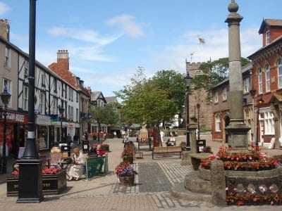 Flowers around the market cross and baskets