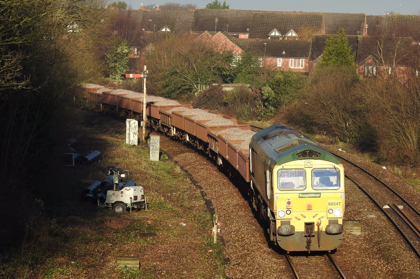 Diesel engine waits with ballast to be used in works at Poulton. Photo Barrie C Woods