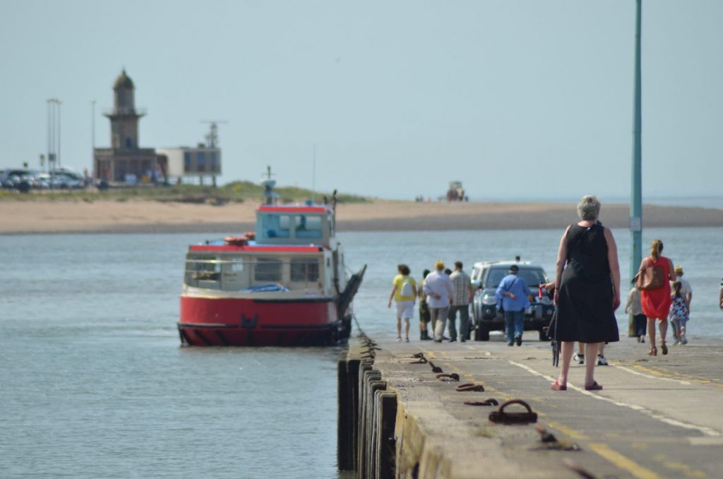 Knott End Ferry on the River Wyre with Fleetwood Lower Lighthouse beyond